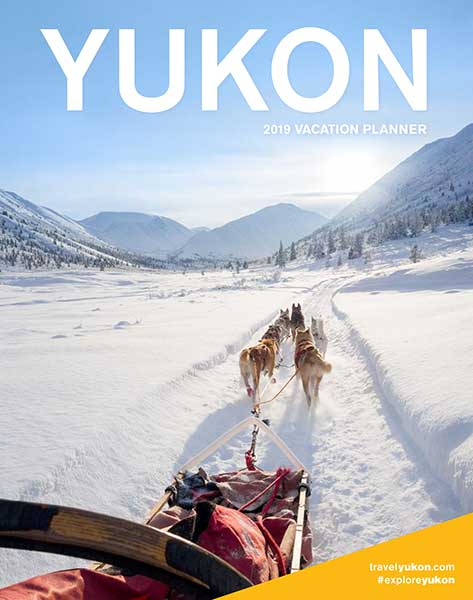 Cover of the vacation planner with dogs pulling a sled